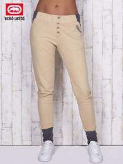 Beżowe spodnie dresowe z szarymi wstawkami