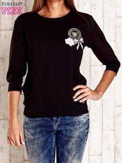 Czarna bluza z naszywkami i ściągaczami