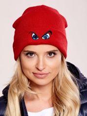 Czerwona czapka beanie z komiksowymi oczami