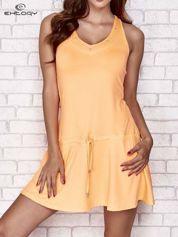 Pomarańczowa sukienka sportowa z kieszonką
