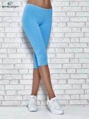 Turkusowe legginsy sportowe termalne z dżetami na nogawkach