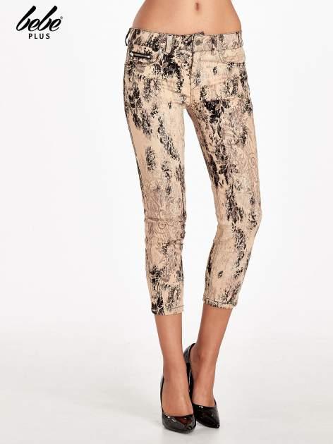 Beżowe spodnie skinny w kwiaty