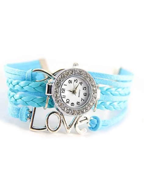 Błękitny zegarek damski na skórzanym , plecionym sznurku