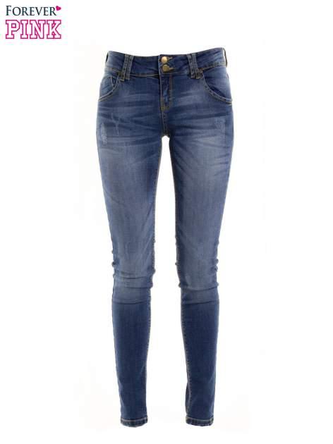 Ciemnieniebieskie jeansy biodrówki na dwa guziki
