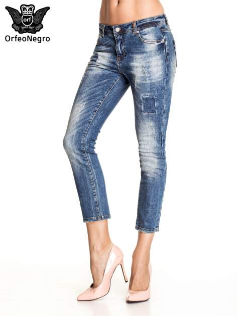 Ciemnoniebieskie spodnie skinny jeans z łatami