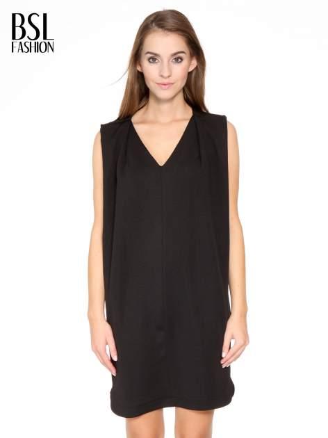 Czarna minimalistyczna sukienka z dekoltem w serek