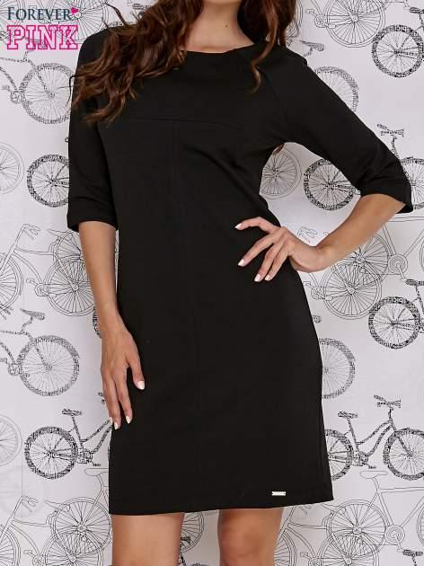 Czarna sukienka dresowa z suwakiem z tyłu