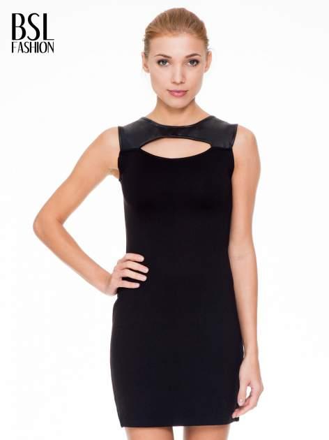 Czarna sukienka ze skórzaną górą i dekoltem typu cut out