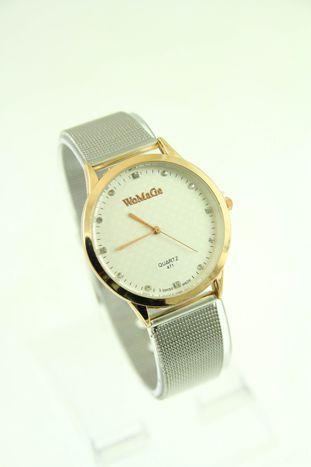 Duży biały zegarek damski na srebrnym pasku