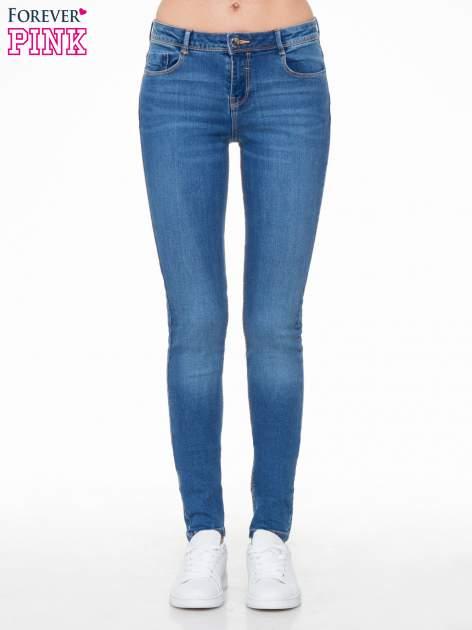 Jasnoniebieskie spodnie typu skinny jeans z cieniowaniem