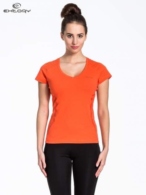 Pomarańczowy t-shirt sportowy z pikowaną wstawką