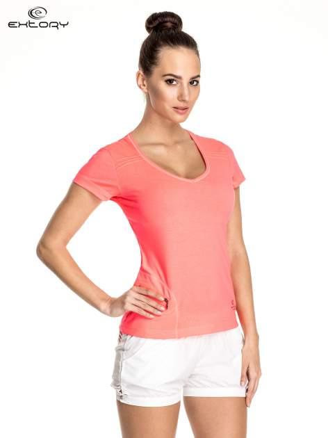 Różowy damski t-shirt sportowy z kieszonką