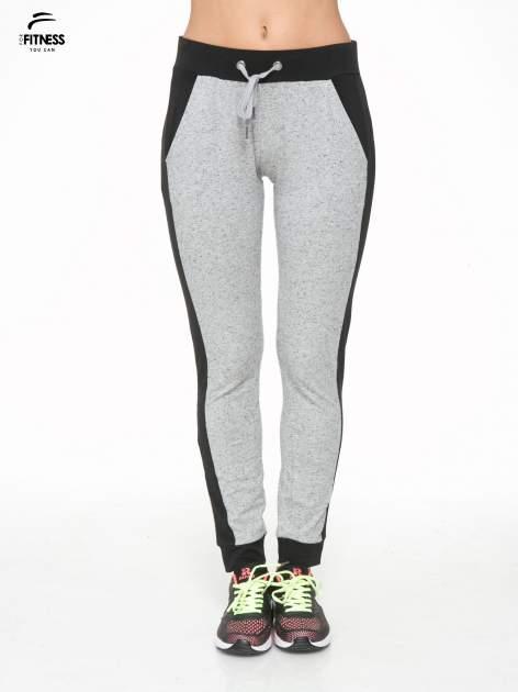 Szare spodnie dresowe damskie z kontrastowymi lampasami po bokach
