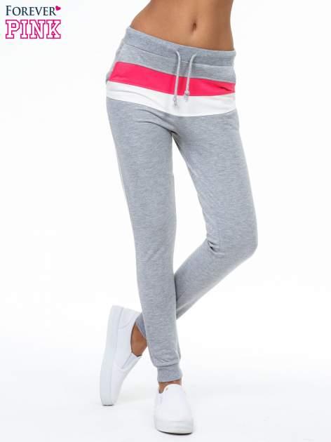 Szare spodnie dresowe z kolorową wstawką
