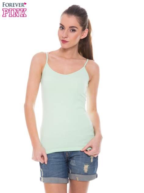 Zielony top na cienkich ramiączkach