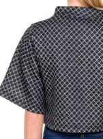 Czarna kraciasta bluzka z kloszowanymi rękawami i półgolfem