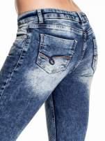 Granatowe lekko marmurowe spodnie ripped jeans