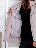 Jasnobeżowa kurtka puchowa z kapturem z futerkiem