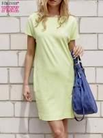 Limonkowa sukienka dresowa z kieszeniami po bokach