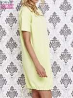 Zielona sukienka dresowa ze ściągaczem na dole