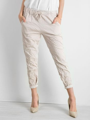 Beżowe spodnie damskie z lampasami