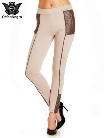 Beżowe spodnie w stylu motocyklowym ze skórzanymi wstawkami i suwakami