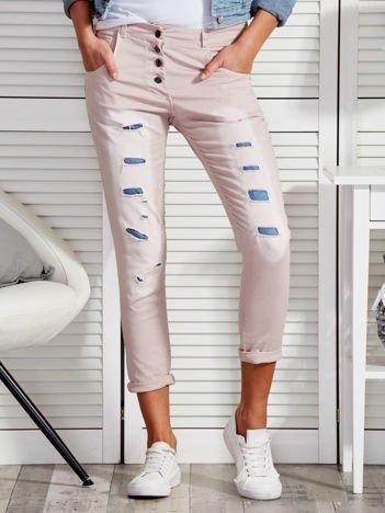 Beżowe spodnie z przedarciami