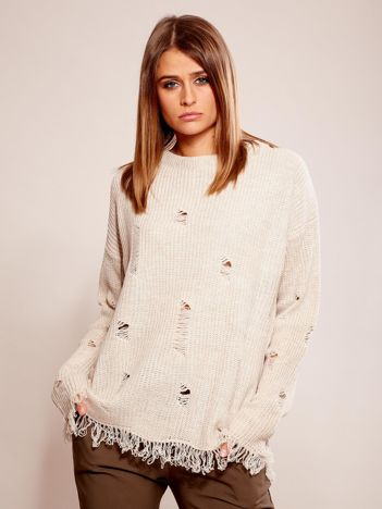 Beżowy sweter oversize