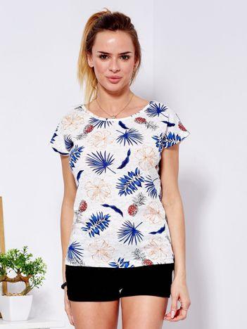 Beżowy t-shirt w roślinne nadruki