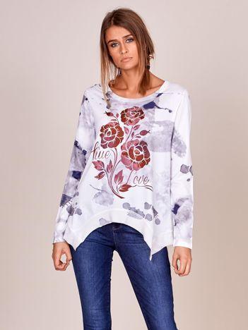 Biała asymetryczna bluzka z kolorowym kwiatem