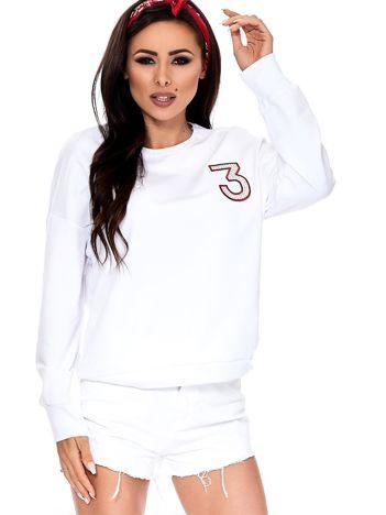 Biała bluza z błyszczącą cyfrą