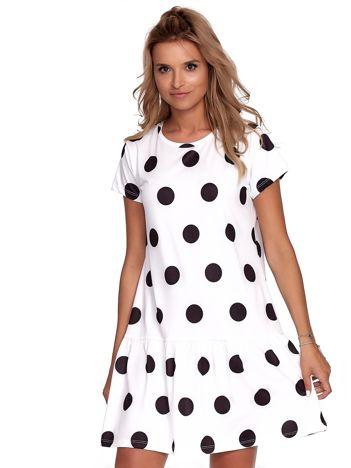Biała sukienka w grochy z falbaną