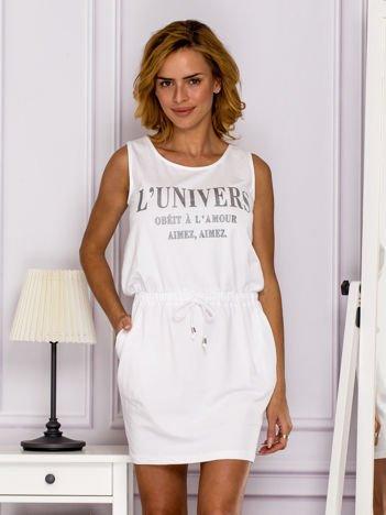Biała sukienka z troczkami