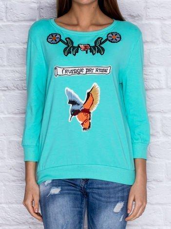 Bluza z kolorowymi naszywkami i napisem miętowa