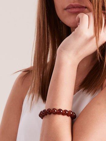 Bransoletka damska na gumce z brązowymi perełkami
