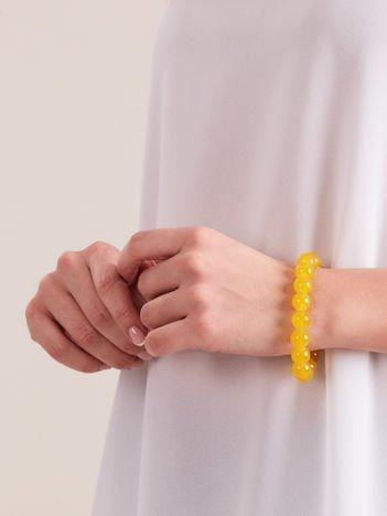 Bransoletka damska na gumce z żółtymi perełkami