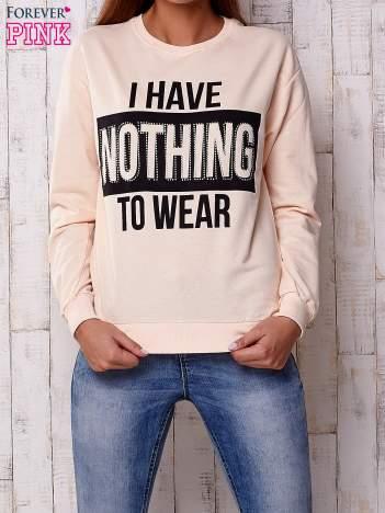 Brzoskwiniowa bluza z napisem I HAVE NOTHING TO WEAR