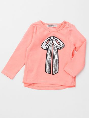 Brzoskwiniowa bluzka dla dziewczynki z cekinową aplikacją