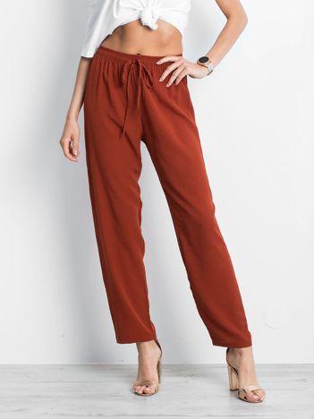 Ceglaste spodnie Inability