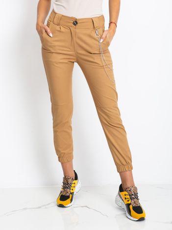 Ciemnobeżowe spodnie Prince