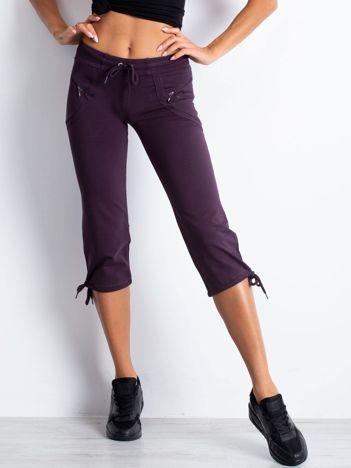 Ciemnofioletowe spodnie dresowe capri z kieszeniami na suwak
