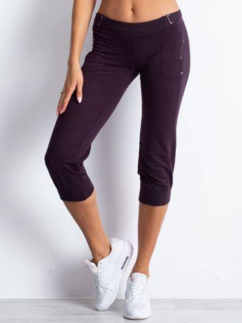 Ciemnofioletowe spodnie dresowe capri z materiałowym paskiem