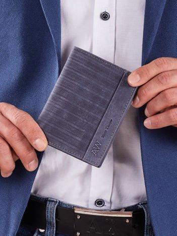 Ciemnoniebieski skórzany męski portfel z tłoczeniem