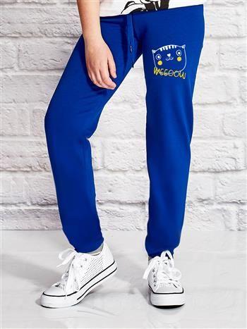 Ciemnoniebieskie spodnie dresowe dla dziewczynki nadruk kota