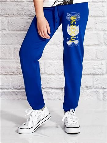 Ciemnoniebieskie spodnie dresowe dla dziewczynki z kocim motywem