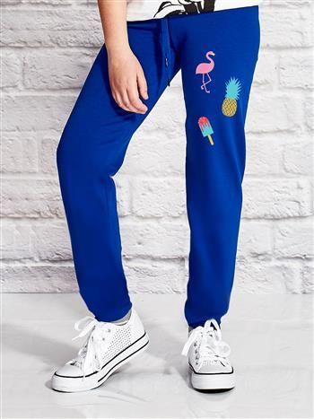 Ciemnoniebieskie spodnie dresowe dla dziewczynki z letnim nadrukiem