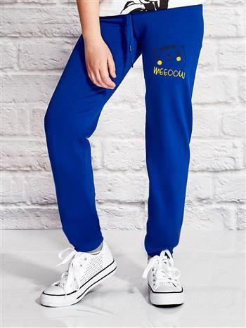 Ciemnoniebieskie spodnie dresowe dla dziewczynki z zabawnym kocim nadrukiem