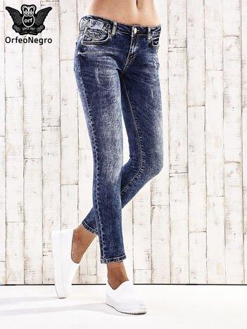 Ciemnoniebieskie spodnie jeansowe marble denim