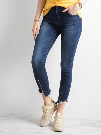 Ciemnoniebieskie spodnie jeansowe z suwakami