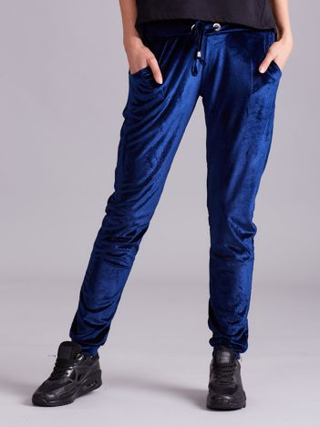 Ciemnoniebieskie welurowe spodnie z troczkami